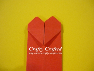 Your origami heart bookmark is done. :)