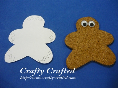 Trace the ginger bread man onto a white piece of paper. Cut out the strips as the 'icing' and glue them onto the ginger bread man.