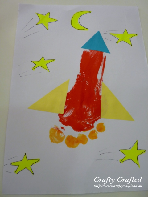 Check out this adorable footprint rocket ship!